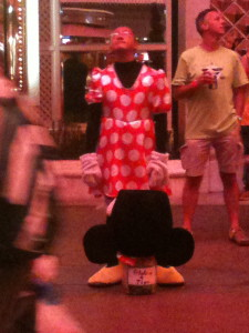Yes....  It's a man dressed as Minnie Mouse.